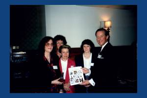 Wimbledon M P, Charles Goodson-Wickes presents library staff with the T.C.Farries award.