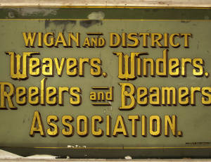 Window panel from the offices of the Wigan and District Weavers, Winders, Reelers and Beamers' Association