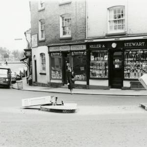 Corner of King Street, and Bridge Street, Hereford, showing shopfronts of Wilsons Supply Stores and Miller & Stewart
