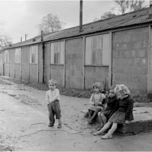 Children play in the rubble of what had been Foxley camp. Built as an American wartime hospital it later became a resettlement camp for Polish refugees where families scattered all over Europe were reunited by the British red Cross.